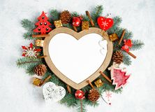 Free Christmas Frame In The Shape Of A Heart Is Surrounded By Branches Of A New Year Tree Christmas Decorations With Copy Space. Top Stock Photo - 134855790