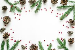 Christmas frame made of fir branches, cones and shining stars. Preparation for the New Year. royalty free stock photos