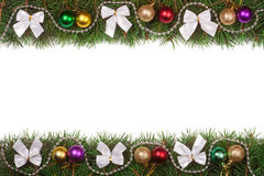 Christmas frame made of fir branches decorated with balls beads and silver bows isolated on white background. Christmas frame made of fir branches decorated with Royalty Free Stock Images