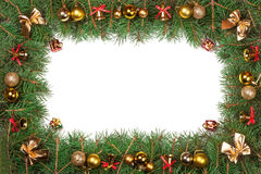 Christmas frame made of fir branches decorated with balls bells and bows isolated on white background.  Stock Photography