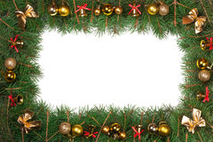 Christmas frame made of fir branches decorated with balls bells and bows isolated on white background.  Stock Photos