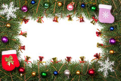 Christmas frame made of fir branches decorated with balls and bells isolated on white background Royalty Free Stock Photos