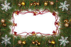 Christmas frame made of fir branches decorated with balls bells and snowflakes isolated on white background Royalty Free Stock Photo