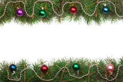 Christmas frame made of fir branches decorated with balls isolated on white background Stock Images