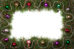 Christmas frame made of fir branches decorated with balls isolated on white background Royalty Free Stock Images