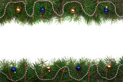 Christmas frame made of fir branches decorated with balls isolated on white background Royalty Free Stock Image