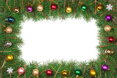 Christmas frame made of fir branches decorated with balls isolated on white background Stock Photography