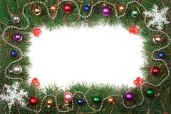 Christmas frame made of fir branches decorated with balls isolated on white background Stock Photo