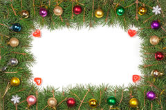 Christmas frame made of fir branches decorated with balls isolated on white background.  Stock Photography