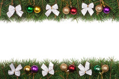 Christmas frame made of fir branches decorated with balls and silver bows isolated on white background. Christmas frame made of fir branches decorated with Royalty Free Stock Photos