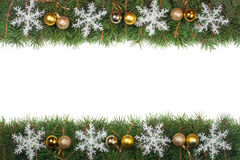 Christmas frame made of fir branches decorated with balls and snowflakes isolated on white background.  Royalty Free Stock Photos