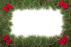 Christmas frame made of fir branches decorated with beads and red bows isolated on white background Stock Image