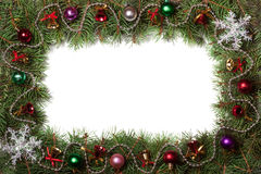 Christmas frame made of fir branches decorated with bells and balls isolated on white background Royalty Free Stock Photo