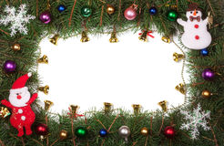 Christmas frame made of fir branches decorated with bells and balls isolated on white background Royalty Free Stock Images