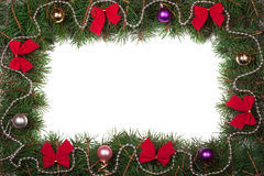 Christmas frame made of fir branches decorated with bows and balls isolated on white background Royalty Free Stock Image
