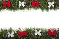 Christmas frame made of fir branches decorated with bows isolated on white background royalty free stock photography