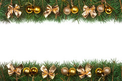 Christmas frame made of fir branches decorated with golden balls and bows isolated on white background.  Royalty Free Stock Photography