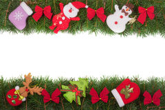Christmas frame made of fir branches decorated with red bows Snowman and Santa Claus isolated on white background.  Royalty Free Stock Photo