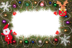 Christmas frame made of fir branches decorated with Santa Claus and balls isolated on white background Royalty Free Stock Photo