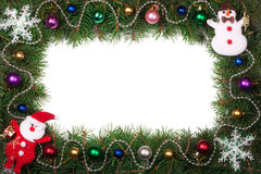 Christmas frame made of fir branches decorated with Santa Claus and balls isolated on white background Stock Photo