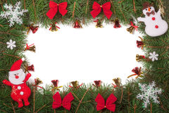 Christmas frame made of fir branches decorated with Santa Claus bows and bells isolated on white background Royalty Free Stock Image