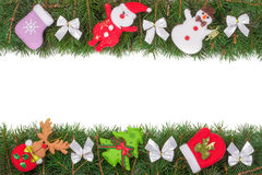 Christmas frame made of fir branches decorated with silver bows Snowman and Santa Claus isolated on white background Stock Photos
