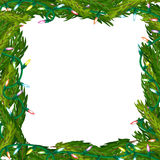 Christmas frame made of fir branches and garlands. Christmas frame made of fir branches adorned with Christmas decorations, gifts, stars and candy Royalty Free Stock Image