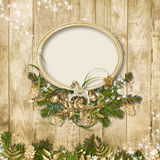 Christmas frame with miraculous garland on a wooden background. Christmas  vintage background  with  beautiful Christmas garland and frame Stock Photo