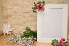 Christmas frame. mock up. Red and green decorative berries. royalty free stock image