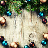 Christmas frame with multicolor baubles and fir branches Royalty Free Stock Photography