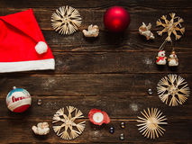 Christmas frame with ornaments and decorations or baubles, snowf. Christmas frame with Christmas ornaments and decorations or baubles, snowflakes, red hat Stock Photography