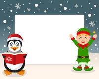 Christmas Frame - Penguin & Green Elf Stock Photo