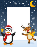 Christmas Frame - Penguin & Reindeer Stock Image