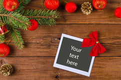 Christmas frame for photo or text on a wooden table. Stock Images