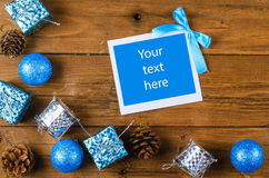 Christmas frame for photo or text on a wooden table. Stock Photo