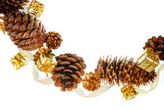 Christmas frame of pine cones and gift boxes on a white background place for text Stock Images
