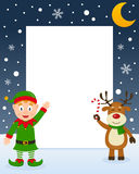 Christmas Frame - Reindeer & Green Elf. Christmas vertical photo frame with a happy green elf smiling and a cute reindeer holding a candy cane in a snowy Royalty Free Stock Photography
