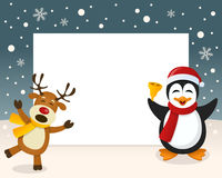 Christmas Frame - Reindeer & Penguin Royalty Free Stock Image