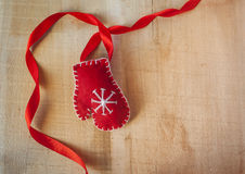 Christmas frame with Santa Claus red mittens on a wooden backgro Royalty Free Stock Images