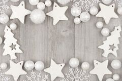 Christmas frame with white ornaments on gray wood Royalty Free Stock Images
