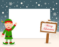 Christmas Frame - Sign & Cute Green Elf. Christmas horizontal photo frame with a happy green elf smiling in a snowy scene with a merry Christmas wooden sign. Eps Royalty Free Stock Images