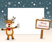 Christmas Frame Sign & Drunk Reindeer. Christmas horizontal photo frame with a drunk reindeer smiling in a snowy scene with a merry Christmas wooden sign Royalty Free Stock Image