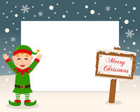Christmas Frame Sign & Happy Green Elf. Christmas horizontal photo frame with a happy green elf smiling in a snowy scene with a merry Christmas wooden sign. Eps Stock Photo