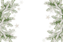 Christmas frame of snow-covered fir branches and place for text.  Stock Image