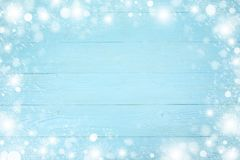 Christmas frame of snowflake with copy space, on blue board wooden background royalty free stock photo