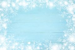 Christmas frame of snowflake with copy space, on blue board wooden background. Top view stock image