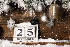 Christmas Frame from Snowy Xmas tree branches and Wooden Calenda. Christmas Frame from Snowy Xmas tree branches, Wooden Block Calendar with 25 December Date and stock photo