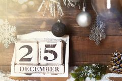 Christmas Frame from Snowy Xmas tree branches and Wooden Calenda. Christmas Frame from Snowy Xmas tree branches, Wooden Block Calendar with 25 December Date and royalty free stock photography