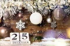 Christmas Frame from Snowy Xmas tree branches and Wooden Calenda. Christmas Frame from Snowy Xmas tree branches, Wooden Block Calendar with 25 December Date and royalty free stock photo