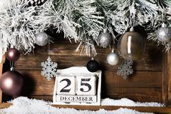 Christmas Frame from Snowy Xmas tree branches and Wooden Calenda. Christmas Frame from Snowy Xmas tree branches, Wooden Block Calendar with 25 December Date and royalty free stock photos